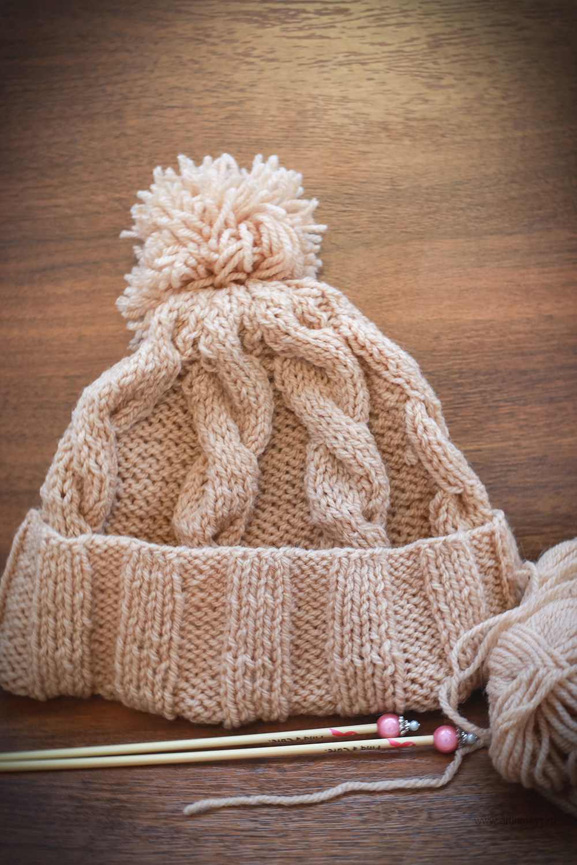 Вязанная шапочка с косами и помпоном, Knitted hat with braids and pom pom